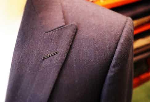 Patrick Reinhardt's Henry Poole suit.