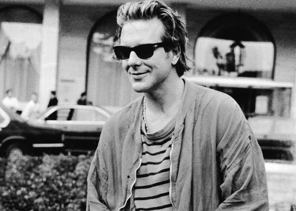 In a casual attire of t-shirt and sunglasses whilst attending the Cannes Film Festival to promote his film Homeboy, 1988. Photo by RDA/Getty Images.