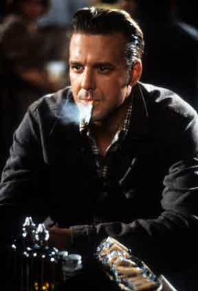 Mickey Rourke smokes in a scene from the film Johnny Handsome, 1988. Photo by TriStar/Getty Images.