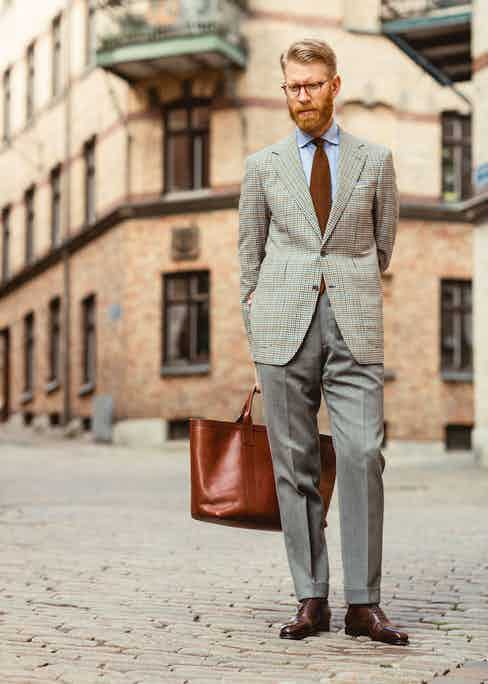"""Olof is a great advocate of bespoke garments for their individuality, and this sports coat, made by friend and tailor Maciej Zaremba, is one of his many examples. """"Zaremba's preferred house style is more Neapolitan with a soft spalla camicia shoulder, but I asked him to make this with a soft roped shoulder. The fabric is a lightweight worsted club check fabric from Fox Brothers, my favourite supplier of fabrics."""""""