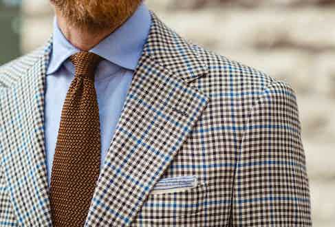 """""""This shirt is made by my favourite bespoke shirtmaker Luca Avitabile, who is a true gentleman and amazing at his craft,"""" Olof tells The Rake. """"He created the perfect fit on my first shirt and has made a few more since. It is pale blue which is the colour I probably wear four days a week."""" In line with Olof's playful approach to traditional dress, he adds unique accessories to his attire such as this knitted silk tie by Parisian brand Robert Kerr. """"I had been looking for a well-made tie of this material that was seven to eight centimetres wide for a long time, and after asking my Instagram followers for suggestions I came across this store. Since then I have bought three ties from them. I love Instagram!"""""""