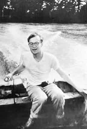 Michael Clark Rockefeller, son of Governor Nelson Rockefeller, driving a boat aged 22, a year before his tragic disappearance during a mission to find primitive art in Dutch New Guinea in 1961.