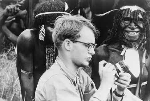 Michael C. Rockefeller photographing the Dani, a neolithic tribe, while on an expedition in New Guinea, 1961.