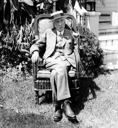 John D. Rockefeller Sr. pictured at his Pocantico Hills home in a three piece suit and boater, circa 1928. Photograph by CSU Archives / Everett Collection.