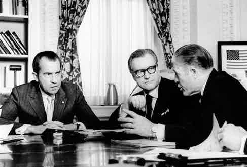 Governor Nelson Rockefeller meets with President Richard Nixon and Secretary of Housing and Development George Romney at the White House, circa 1971. Photograph by Everett Collection Historical/Alamy Stock Photo.