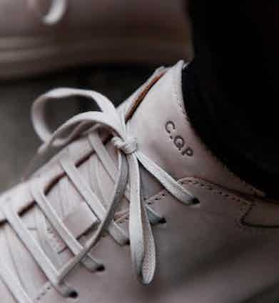 The hidden eyelets of C.QP's ultra-minimal Tarmac sneaker. Photograph by James Munro.