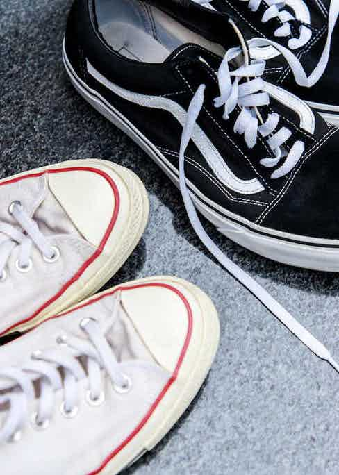 Left: Converse Chuck Taylor All Star in white canvas; right: Vans Old Skool in black canvas and suede. Photograph by James Munro.