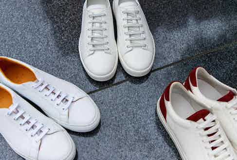 From left to right: Ludwig Reiter tennis shoes in white perforated leather; Santoni low-tops in white leather; Brunello Cucinelli Apollo Sport sneakers in white calfskin and maroon suede. Photograph by James Munro.