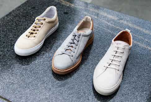 From left to right: North 89 No 1 Papyrus sneakers in beige suede; Brunello Cucinelli Icaro sneakers in grey nubuck and calfskin; C.QP Tarmac sneakers in grey nubuck. Photograph by James Munro.