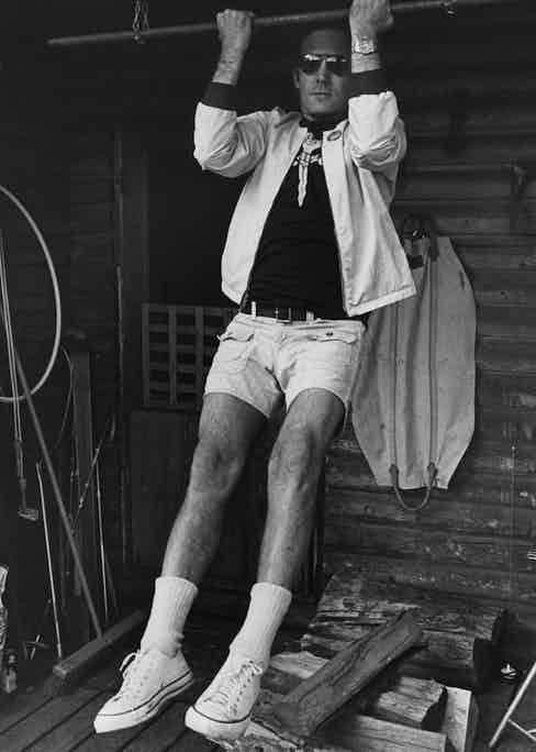 Journalist Hunter S. Thompson sports Converse All Stars low-tops whilst doing pull ups at his ranch near Aspen, Colorado, circa 1976. Photo by Michael Ochs Archives/GettyImages.