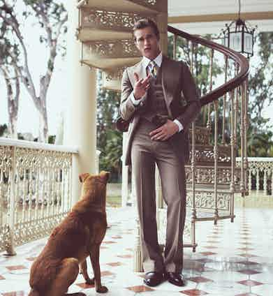 Jules Raynal wears chocolate brown leather Oxford shoes by Crockett & Jones beneath a vintage three-piece suit by Chittleborough & Morgan. The trousers feature a generous turn up and demonstrate an elegant 'break' over the shoes.