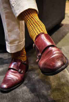 Luxury menswear stylist Joe Ottoway wears socks of his own design – the result of a unique collaboration with the London Sock Co., a houndstooth pattern was chosen for its British quality, and the colours inspired by that of British military dress.