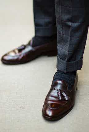Pairing a well-appointed trouser cuff with dark grey woollen socks and leather tassel loafers, Manolo Costa cuts a stylish figure.