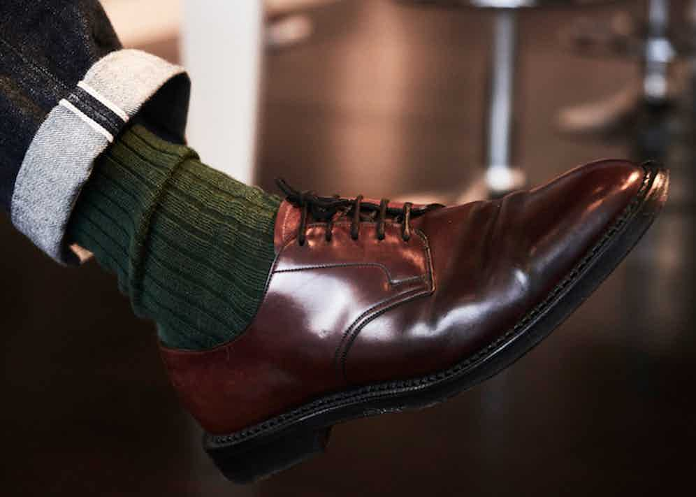 Toby Bateman pairs RRL selvedge denim with English-made cordovan leather Edward Green shoes, and thick bottle-green Corgi cotton socks.