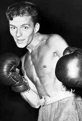Having grown up in the harsh Hoboken, New York in the inter-war years, Sinatra became an enthusiastic boxer and can be seen here posing for a press conference with his boxing gloves in Hollywood, 1947. Photo by Bettmann/CORBIS.