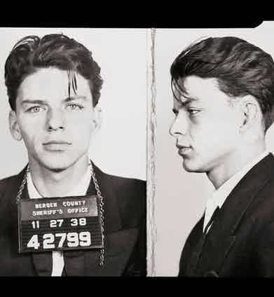 Sinatra's mug shot after he was arrested by the Bergen County, New Jersey sheriff in 1938, charged with adultery. However, the charges were eventually dismissed.