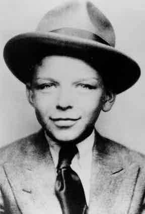 Even at the tender age of seven, Frank Sinatra was dapper and sophisticated as he is seen here in a suit, tie and fedora, 1922.
