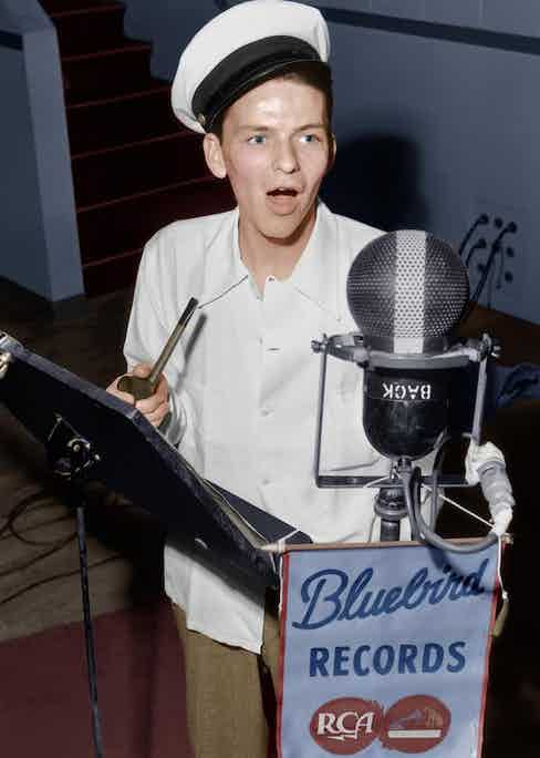 Sinatra pays homage to his hero Bing Crosby with his pipe and yachting cap at the Bluebird Records studio, 1942. Photo by Rca/Kobal/REX/Shutterstock.