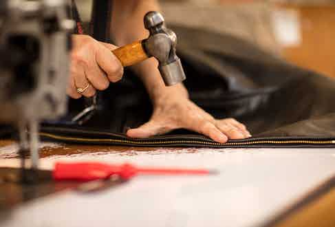 Adding the central zip to an Aero Leather jacket.