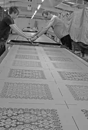 Hand screen printing Augustus Hare's ties.