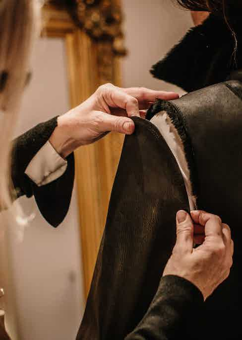Pauline Harris putting together a Cromford Leather jacket.