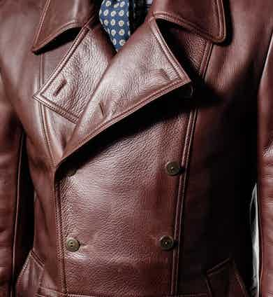 The Eastwood coat features military buttons and epaulets.