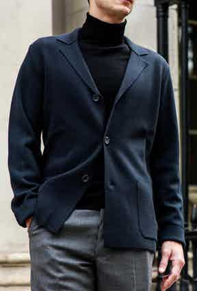 This knitted blazer by Falke can be layered with a simple roll neck. Photograph by James Munro.