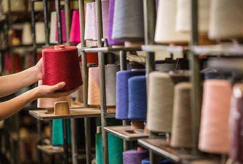 Rolls of different coloured yarn in Falke's workshop.