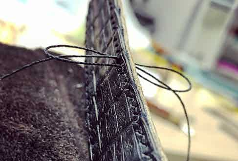 Waxed thread is used for extra strength and durability.