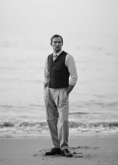 Robertas wears a Brunello Cucinelli double-breasted cotton-jersey waistcoat, also known as a vest, with wide-legged trousers by Caruso and a white shirt by Gieves & Hawkes.