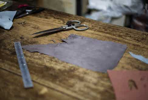 Preparing the leather for Omega Srl's gloves. Photograph by Stephane Buttice.