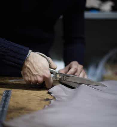 The leather for each pair of gloves is cut by hand. Photo by Stephane Buttice.