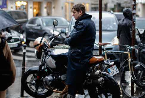 The Rake contributor Robert Spangle braving the city rain with a BMW motorcycle. Photography by Zach Dodds.