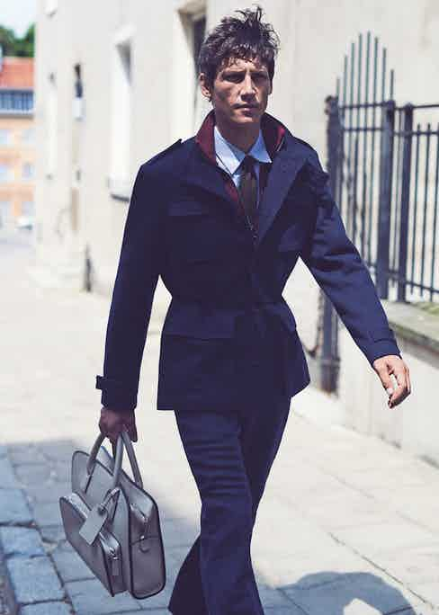 Blue wool field jacket, Canali; burgundy zip sports jumper, Lanvin; indigo selvedge-denim jeans, Berluti; blue micro-check cotton shirt, Helbers; brown silk knitted tie, Drake's; cream leather Private bag, Giorgio Armani.