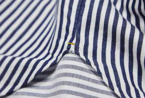 Each shirt has gold thread stitched into the side gusset. Photograph by James Munro.