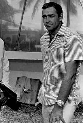 Connery wears a Breitling Top Time chronograph watch in the movie Thunderball, 1965. The watch was modified for the film to include a stainless steel case, black dial, two metal subdials and a metal tachymeter ring around the dial.
