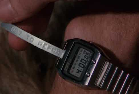 Moore's Seiko 0674 5009 liquid crystal digital watch in The Spy Who Loved Me boasted a miniature tickertape communicator.