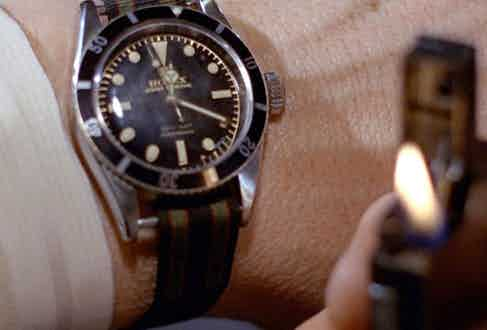 A close-up of the Submariner ref. 6538 with a striped NATO strap as seen in Goldfinger.