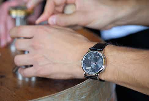 An engraver from the Antinori Chianti Classico winery wearing A. Lange & Söhne Lange 1 watch.