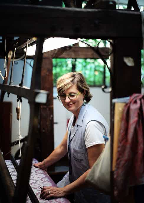 One of the specialists at a loom at the textile mill Antico Setificio Fiorentino.