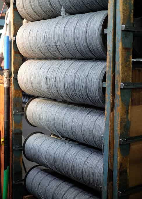 Rolls of wool ready for weaving.