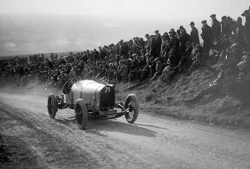 Clement competing in 1922 with crowds perilously close the road.