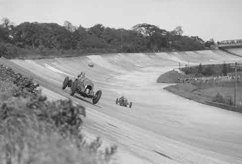Birkin, with his wheels off the ground, leads at Brooklands, 1932. Photo by National Motor Museum/REX/Shutterstock.