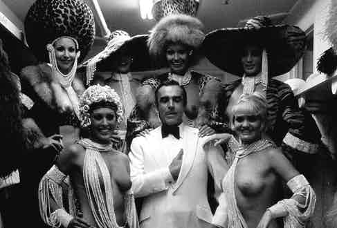 Sean Connery among Las Vegas showgirls on the set of Diamonds Are Forever, 1968. Photo by Terry O'Neill.
