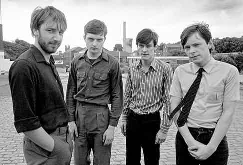 Manchester band Joy Division pictured on Waterloo Road in Stockport, 1979. Photograph by Paul Slattery/Retna Pictures.