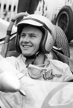 A grin from McLaren at the 1965 Formula One Grand Prix, driving for the Cooper Car Company.
