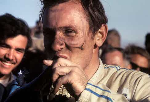 Celebrating his victory at the Can-Am round in Riverside, California in 1967. (Photograph by Bernard Cahier).