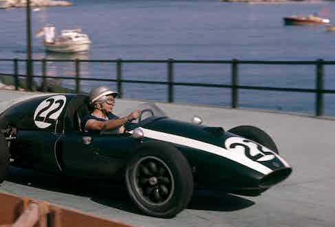 Speeding through Monaco in the Grand Prix of May 1959 in a short sleeve T-shirt, bare hands and an open face helmet. (Photograph by Bernard Cahier).