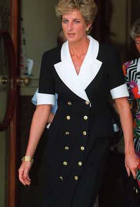The Princess of Wales in a black suit dress with contrasting white lapels and cuffs at Wimbledon, 1994.
