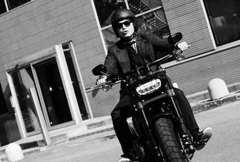 Wei Koh on a Harley Davidson 2018 Fat Bob, wearing a Huntsman jacket (available soon on TheRake.com). Photograph by Stéphane Buttice.